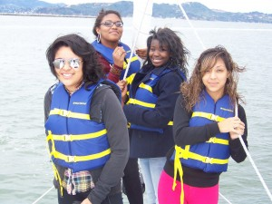 Four STEM Trekkers enjoy sailing on San Francisco Bay